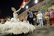Woman in elaborate white dress costume for Salgueiro Samba School doing the final practice performance of their Carnival procession in the Sambadrome, Rio de Janeiro, Brazil