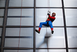 © licensed to London News Pictures. London, UK 14/05/2014. A city traders dressed as Spiderman abseil off the Lloyd's building to raise funds for London-based international charity 'RedR' on Wednesday, 14 May 2014. Photo credit: Tolga Akmen/LNP