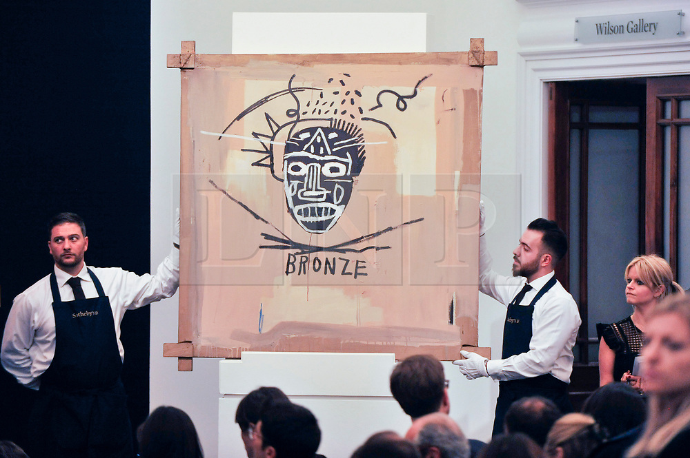 © Licensed to London News Pictures. 05/10/2017. London, UK.  'Bronze', 1982, by Jean-Michel Basquiat sold for a hammer price of GBP4,700k (Est. GBP5,000-7,000k) at the Italian and Contemporary Art evening auction at Sotheby's, New Bond Street, coinciding with the opening of the London's Frieze Art Fair. Photo credit : Stephen Chung/LNP