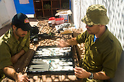 Israel, West Bank, Israeli reserve soldiers playing backgammon at leisure during active duty. Backgammon is the most popular pastime during active service