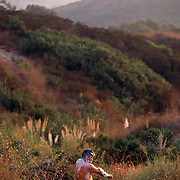 A migrant worker bathes in the hills of San Diego, California.  PLEASE CONTACT TODD BIGELOW DIRECTLY WITH YOUR LICENSING REQUEST. THANK YOU!