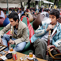 """Istanbul, Turkey 07 May 2006.<br /> Turkish people in a """"Narghile café"""" of Tophane neighborhood. These coffee shops are frecuented by turkish to meet friends, drink coffe or tea, smoke Nargile or play table games.<br /> Photo: Ezequiel Scagnetti"""