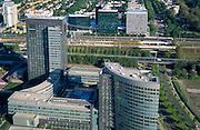 Nederland, Amsterdam, Zuidas, WTC, 25-09-2002; hoofdkantoor ABN AMRO (voorgrond) aan de Van Leijenberglaan, daarachter de ringweg A10 met tussen beide rijbanen het metro en NS Station Zuid-WTC. Aan de andere van de A10 het World Trade Centre (blauwgroen) met rechts een van de uitbreidingen (blauw oranje); WTC, economie, bedrijvigheid, stadsgezicht, kantoren, verzekeringen; zie ook andere foto's van deze lokatie; ABN AMRO head office, behind the A10 ring road with two lanes between the metro and railway station South WTC. On the other of the A10 the World Trade Center (blue green) with a right of the extensions (blue orange); WTC, economics, business, city, offices, insurance, bank, banking, money;<br /> luchtfoto (toeslag), aerial photo (additional fee)<br /> foto /photo Siebe Swart