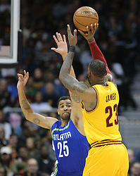 March 3, 2017 - Atlanta, GA, USA - Cavaliers LeBron James launches a three point shot over Hawks guard Thabo Sefolosha during the second half in a NBA basketball game at Philips Arena on Friday, March 3, 2017, in Atlanta, GA. (Credit Image: © Curtis Compton/TNS via ZUMA Wire)