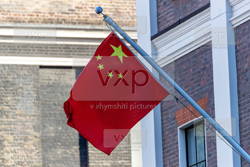"""People's Republic of China flag is seen waving in the Balcony of the Chinese Embassy in London on Monday, July 20, 2020 - as the U.K., tensions with China are rising. United Kingdom suspended the extradition treaty with Hong Kong """"immediately and indefinitely"""" as well as existing embargo arms against China is extended to Hong Kong U.K. Foreign Secretary Dominic Raab announced on Monday afternoon through a statement in the British Parliament. (VXP Photo/ Vudi Xhymshiti)"""