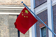 "People's Republic of China flag is seen waving in the Balcony of the Chinese Embassy in London on Monday, July 20, 2020 - as the U.K., tensions with China are rising. United Kingdom suspended the extradition treaty with Hong Kong ""immediately and indefinitely"" as well as existing embargo arms against China is extended to Hong Kong U.K. Foreign Secretary Dominic Raab announced on Monday afternoon through a statement in the British Parliament. (VXP Photo/ Vudi Xhymshiti)"