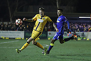 AFC Wimbledon striker Lyle Taylor (33) chases Sutton United Dean Beckwith (4) during the The FA Cup third round replay match between AFC Wimbledon and Sutton United at the Cherry Red Records Stadium, Kingston, England on 17 January 2017. Photo by Stuart Butcher.
