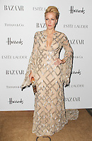 LONDON - OCTOBER 31: Gillian Anderson attended the Harper's Bazaar Women of the Year Awards at Claridge's Hotel, London, UK. October 31, 2012. (Photo by Richard Goldschmidt)