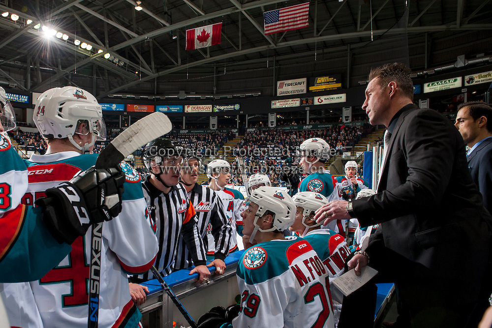 KELOWNA, CANADA - FEBRUARY 10: Kelowna Rockets' head coach Jason Smith speaks to referee Ward Pavemen and linesman Dustin Minty from the bench against the Vancouver Giants on February 10, 2017 at Prospera Place in Kelowna, British Columbia, Canada.  (Photo by Marissa Baecker/Shoot the Breeze)  *** Local Caption ***