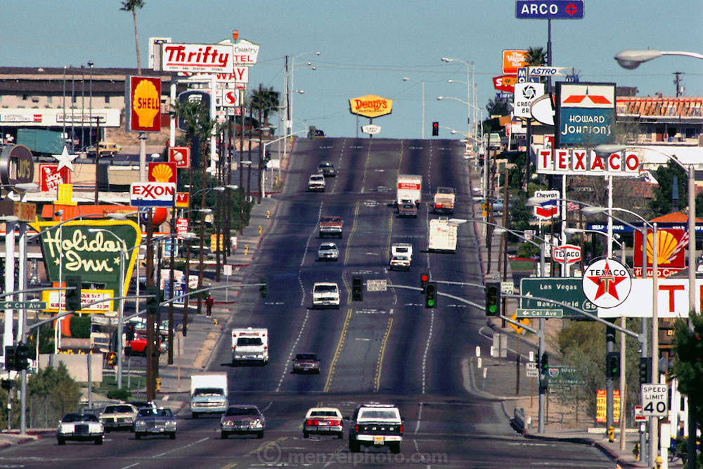Barstow, California Main Street crammed with gas, hotel, and fast food signs. USA.