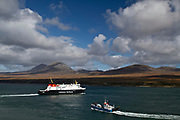 The Calmac ferry, Finlaggan and the Jura ferry viewed in the Sound of Islay from above Port Askaig
