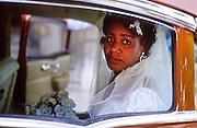 25 JULY 2002 - HAVANA, HAVANA, CUBA: A woman in the back of a car moments after her wedding in Havana, Cuba, July 25, 2002..PHOTO BY JACK KURTZ