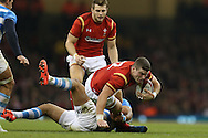Scott Williams of Wales is tackled by Matias Orlando of Argentina. Under Armour 2016 series international rugby, Wales v Argentina at the Principality Stadium in Cardiff , South Wales on Saturday 12th November 2016. pic by Andrew Orchard, Andrew Orchard sports photography