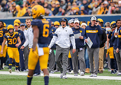 Nov 23, 2019; Morgantown, WV, USA; West Virginia Mountaineers head coach Neal Brown watches from the sidelines during the first quarter against the Oklahoma State Cowboys at Mountaineer Field at Milan Puskar Stadium. Mandatory Credit: Ben Queen-USA TODAY Sports