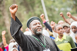 """16 June 2017, Nairobi, Kenya: Fr Joseph Mutie, from the Organization of African Instituted Churches in Kenya (middle) leads to way. On 16 June, more than 500 people gathered to commemorate the Day of the African Child in Nairobi, Kenya, and to speak up publicly for the rights of children and adolescents living with HIV. Religious leaders from a range of different faith communities and traditions led a march through the streets of Nairobi, from the All Saints Cathedral to Ufungamano House, accompanied by hundreds of youth and young children from local faith-sponsored schools, after which a ceremony was held where the religious leaders committed publicly to work for children's rights to HIV testing, access to treatment, and freedom from stigma and discrimination, to make sure that those who are in need of treatment are also able to stay on treatment. The day was organized by the World Council of Churches Ecumenical Advocay Alliance together with Inerela+ Kenya, with contributions from a range of other partners. At end of the ceremony, the WCC-EAA launched a global Call to Action entitled """"Act now for children and adolescents living with HIV"""", which was signed by the range of religious leaders."""