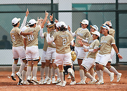 JAKARTA, Aug. 24, 2018  Players of Japan celebrate after women's Team Grand Final of softball against Chinese Taipei at the 18th Asian Games in Jakarta, Indonesia on Aug. 24, 2018. Japan won the gold medal by 7-0. (Credit Image: © Ding Ting/Xinhua via ZUMA Wire)