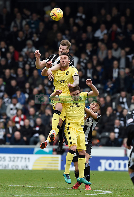 St Mirren's Gary MacKenzie heads clear from and Livingston's Lee Miller and Scott Pittman during the Ladbrokes Scottish Championship match at the Paisley 2021 Stadium.