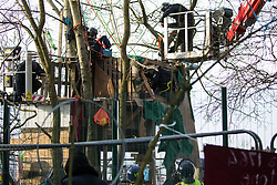 Steeple Claydon, UK. 24 February, 2021. Thames Valley Police officers acting on behalf of HS2 Ltd use a cherry picker to evict activists opposed to the HS2 high-speed rail link from ancient woodland known as Poors Piece. Thames Valley Police stepped in to replace National Eviction Team bailiffs. The activists created the Poors Piece Conservation Project in the woodland in spring 2020 after having been invited to stay on the land by its owner, farmer Clive Higgins.