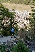 Stubai Valley landscape, Tyrol, Austria. male Hiker walking on the trail
