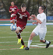 Fort Ann's Tyler Ward (21) moves the ball pastHayden Guay (16) of Chazy during the Class D state semifinals at Faller Field in Middletown on Saturday. Nov. 16, 2013. (Tom Bushey – Special to The Post-Star)