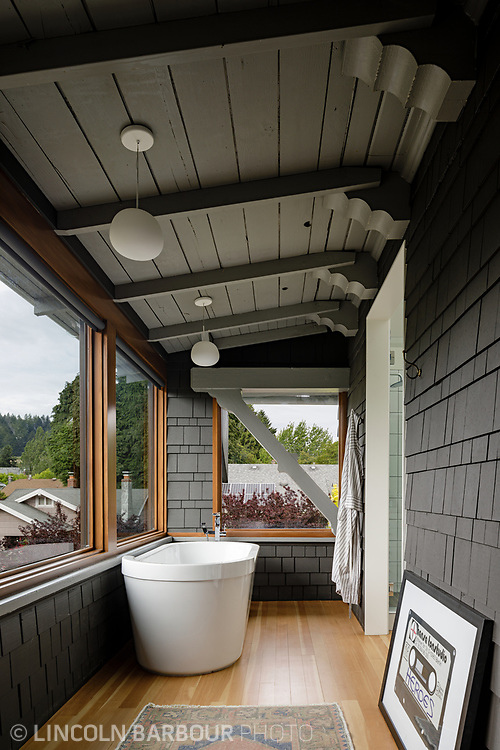 A remodeled porch with a soaking tub and a nice view.