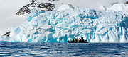 Ecotourists in from of spectacular ice formations at Astrolabe Island, Antarctic Peninsula.