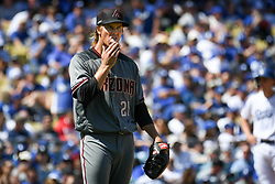 March 28, 2019 - Los Angeles, California, U.S. - Arizona's Zack Greinke, #21, started for the Diamondbacks but ran into trouble early against the Dodgers and pitched only 4 innings on Opening Day at Dodger Stadium Thursday, March 28, 2019. (Credit Image: © Hans Gutknecht/SCNG via ZUMA Wire)