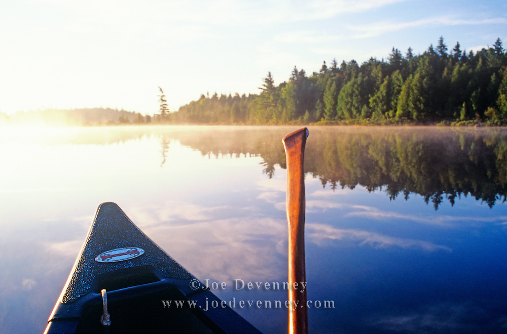 Canoe at sunrise on Northern Roach Pond. Maine