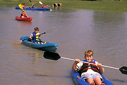 Stock photo of children kayaking