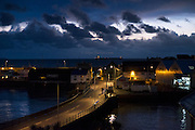 Dawn appears over the horizon from Penzance harbour - Scillonian ferry in dry dock