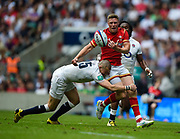 England's Mike Brown's tackle dislodges the ball from the grasp of Wales' Rhys Priestland during the The Old Mutual Wealth Cup match England -V- Wales at Twickenham Stadium, London, Greater London, England on Sunday, May 29, 2016. (Steve Flynn/Image of Sport)