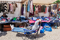 Second hand clothes stalls at Sunday Mauerpark flea market in Mauerpark Prenzlauer Berg Berlin Germany
