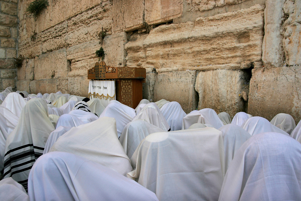 Ultra-Orthodox Jews covered in white prayer shawls hold the four species as they recite the Priestly Blessing Prayer, or Birkat Cohanim, at the Western Wall, Judaism's holiest site, in Jerusalem, on September 30, 2007, as part of the Jewish holdiay of Sukkot (Tabernacles). Thousands of Jews make the pilgrimage to Jerusalem during Sukkot, which commemorates the desert wanderings of the Israelites after their exodus from Egypt. The Priestly Blessing prayer is said twice yearly by Cohens who are the descendents of the high priests of the ancient Temple in Jerusalem.