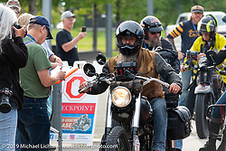 Shane Masters checks in with officials in Milwaukee on his Class III 1948 Indian Chief in the Cross Country Chase motorcycle endurance run from Sault Sainte Marie, MI to Key West, FL (for vintage bikes from 1930-1948). Stage 2 from Ludington, MI to Milwaukee, WI, USA. Saturday, September 7, 2019. Photography ©2019 Michael Lichter.