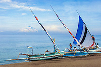 Nusa Tenggara, Lombok, Senggigi. Traditional sail vessels on west Lombok. Bali in the background with Gunung Agung covered in clouds.