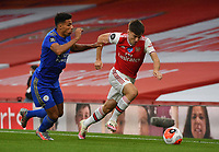 Football - 2019 / 2020 Premier League - Arsenal vs. Leicester City<br /> <br /> Arsenal's Kieran Tierney holds off the challenge from Leicester City's James Justin, at the Emirates Stadium.<br /> <br /> COLORSPORT/ASHLEY WESTERN