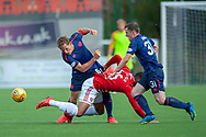 Christophe Berra of Heart of Midlothian and Bobby Burns of Heart of Midlothian tackles Mason Bloomfield of Hamilton Academical FC during the Ladbrokes Scottish Premiership League match between Hamilton Academical FC and Heart of Midlothian FC at New Douglas Park, Hamilton, Scotland on 4 August 2018. Picture by Malcolm Mackenzie.