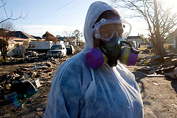 21December 05. New Orleans, Louisiana.  New Orleans Louisiana. Post Katrina aftermath.<br /> Jackie Russell stands outside her devastated home at 2416 Desire Street in the 9th Ward long after the devastating flood from Hurricane Katrina subsided. Jackie just wants to return home and had until this point been emotionally unable to deal with gutting the house she grew up in. Her hope is to be able to repair her house and bring her elderly mother back home before she dies. Jackie was only able to save a few precious china items, the rest of her house and all her belongings had to be thrown in the street.<br /> Photo; ©Charlie Varley/varleypix.com