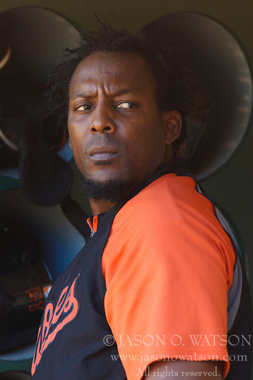 August 15, 2011; Oakland, CA, USA;  Baltimore Orioles designated hitter Vladimir Guerrero (27) stands in the dugout before the game against the Oakland Athletics at O.co Coliseum.  Baltimore defeated Oakland 6-2.