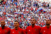 Russian fans cheer for their team before the 2018 FIFA World Cup Russia group A match between Uruguay and Russia at Samara Arena on June 25, 2018 in Samara, Russia.
