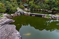 """Zensuiji is a temple whose main hall was built in 1366 during the Nanbokucho period and is a national treasure. TheHyakuden-no-Ike Pond onthe sleeve of the main hall isa pondstrolling garden.The current appearance was recentlyrenovated but the history of Ikezumi dates back to the beginning of the Heian period. It was founded in an ancient temple called at the beginning of the Nara period.At the beginning of the Heian period,Saichodiscovered this """"Hyakuden Pond"""" when he visited this area. Supposedly, Saicho found the golden Yakushi Buddha in the pond, which was originally created by the water flowing from the mountain, and realizes that the water in this pond is sacred water.After that, whenhe gave it toEmperor Kanmuand prayed for healing, he recovered in about a week, so the temple was given the name of Zensuiji which continues to this day - though not to be confused with Zentsuji in Ehime Prefecture the birthplace of Kobo Daishi, important in its own right."""