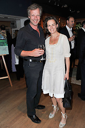 HUGO & LOUISA BURNAND at a party to celebrate the publication of 'Garden' by Randle Siddeley held at Linley, 60 Pimlico Road, London on 24th May 2011.