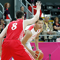 31 July 2012: China Jianlin Yi looks to pass the ball during the 73-54 Russia victory over China, during the men's basketball preliminary, at the Basketball Arena, in London, Great Britain.