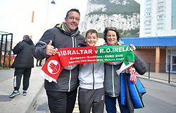 Fans hold a half and half scarf outside the stadium prior to the UEFA Euro 2020 Qualifying, Group D match at the Victoria Stadium, Gibraltar.