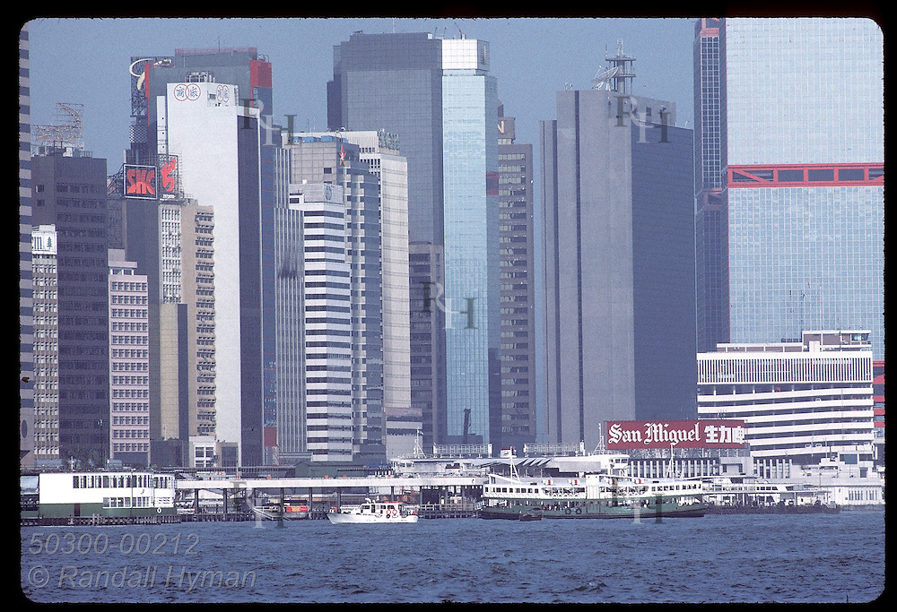 The skyscrapers of Central District tower over the Star Ferry Pier on Hong Kong Island. Hong Kong