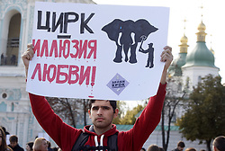 September 30, 2018 - Kiev, Kiev, Ukraine - A man is seen holding a placard  written The Circus is the illusion of love during the protest..Thousands of participants attend the march in downtown demanding for a prohibition in the use of animals in circuses, the goal of the march is to popularize humanistic values and protect animals from cruelty and mockery. (Credit Image: © Pavlo Gonchar/SOPA Images via ZUMA Wire)