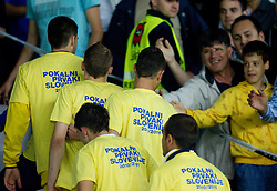 Players of Domzale and fans celebrate after winning the football match between NK Domzale and NK Maribor in final match of Hervis Cup, on May 25, 2011 in SRC Stozice, Ljubljana, Slovenia. Domzale defeated Maribor and became Slovenian Cup Champion 2011. (Photo By Vid Ponikvar / Sportida.com)