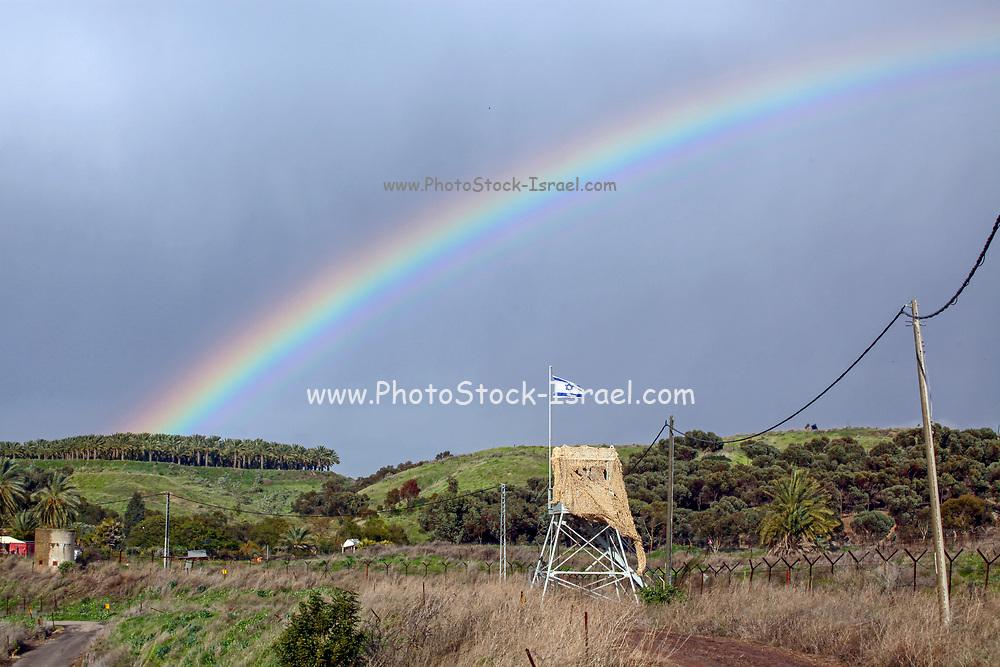 Rainbow over the Israeli flag. Photographed at the Isle of Peace at the (now unused) Naharaim Hydroelectric plant on the Israeli Jordanian border.