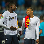 ANDORRA LA VELLA, ANDORRA. June 1.  Kylian Mbappe #10 of France and Kurt Zouma #15 of France embrace at the end of the game during the Andorra V France 2020 European Championship Qualifying, Group H match at the Estadi Nacional d'Andorra on June 11th 2019 in Andorra (Photo by Tim Clayton/Corbis via Getty Images)