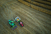 """SHOT 10/17/19 6:20:15 PM - Aerial photos of a farmer harvesting corn with a combine outside of Moravia, Iowa as the growing season comes to a close. The modern combine harvester, or simply combine, is a versatile machine designed to efficiently harvest a variety of grain crops. The name derives from its combining four separate harvesting operations—reaping, threshing, gathering, and winnowing—into a single process. The production of corn (Zea mays mays, also known as """"maize"""") plays a major role in the economy of the United States. The US is the largest corn producer in the world, with 96,000,000 acres  of land reserved for corn production. Corn growth is dominated by west/north central Iowa and east central Illinois. Approximately 13% of its annual yield is exported.  (Photo by Marc Piscotty / © 2019)"""